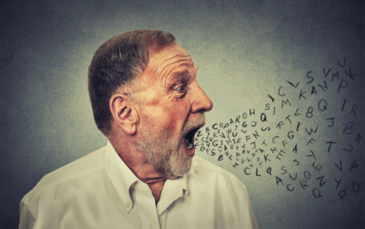 Man talking with alphabet letters coming out of mouth
