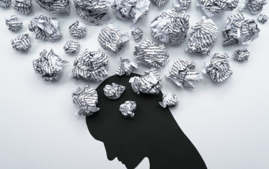 Waste paper and head silhouette.