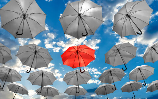 umbrella standing out from the crowd unique concept mental health