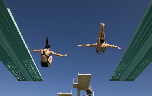 Two women diving from diving board